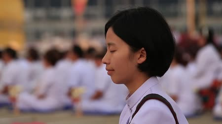 indian ethnicity : BANGKOK, THAILAND - FEBRUARY 22, 2016: Unidentified Thai girl during Buddhist ceremony Magha Puja Day in Wat Phra Dhammakaya
