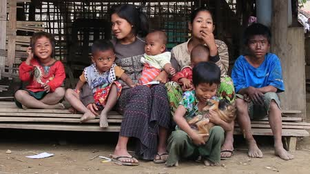 hobo : MRAUK-U, MYANMAR - JANUARY 28, 2016: Unidentified poor family sits on the street. Poverty is a major issue in Burma