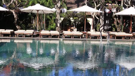 holiday villa : Beach chairs near swimming pool in tropical resort. The island of Bali, Indonesia