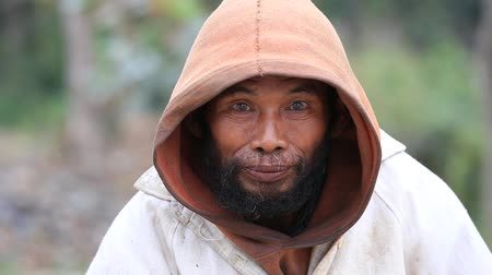 hobo : MRAUK-U, MYANMAR - JANUARY 27, 2016: Unknown portrait beggar man, outdoors, Burma Stock Footage
