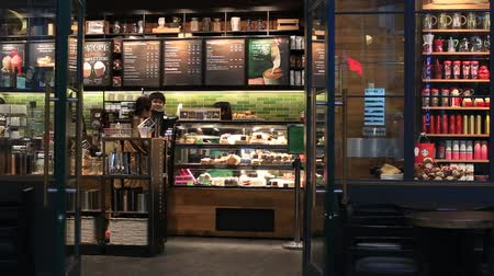 barmetro : BANGKOK, THAILAND - JANUARY 07, 2016: Unidentified people in coffee house Starbucks in Siam Paragon Mall. With 300,000 sqm of retail space Siam Paragon is one of the worlds largest malls