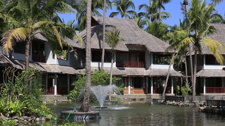 holiday villa : Pond, palm trees and the house next to the tropical beach. Ngapali, Myanmar Stock Footage