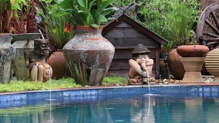 holiday villa : Decorative fountain in a swimming pool next to the tropical garden. Island Koh Samui, Thailand Stock Footage