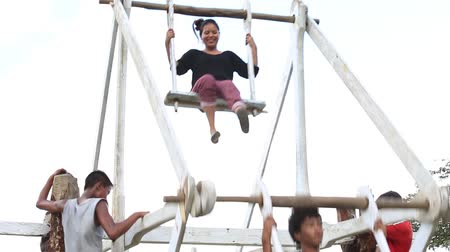 valiant : POKHARA, NEPAL - OCTOBER 04, 2016: Brave children rides on a very big wooden swing