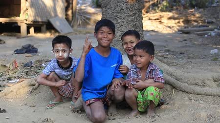 hobo : MRAUK-U, MYANMAR - JANUARY 27, 2016: Unidentified poor children on the street. Poverty is a major issue in Burma Stock Footage