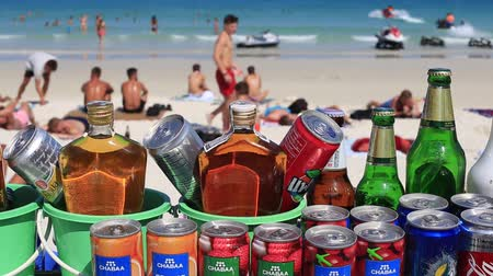 full bucket : KOH PHANGAN, THAILAND - MARCH 02, 2018: Closeup to buckets which have a selection of soft drinks and strong alcohol spirits