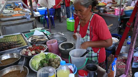 market vendor : KOH PHANGAN, THAILAND - FEBRUARY 15, 2018: Street trade: thai vendor in the island of Koh Phangan, Thailand