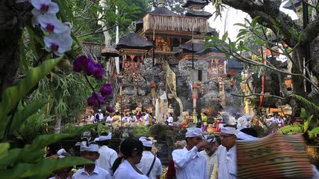procession : UBUD, BALI, INDONESIA - MARCH 24, 2018: Unidentified Indonesian people at a temple in Ubud, island Bali, Indonesia