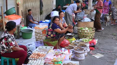 market vendor : UBUD, BALI, INDONESIA - MARCH 29, 2018: Ubud, island Bali, Indonesia. Early morning fruit and vegetable market