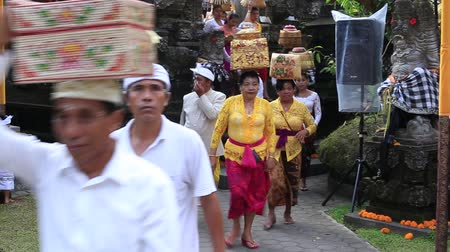 procession : UBUD, BALI, INDONESIA - MARCH 23, 2018: Unidentified Indonesian people at a temple in Ubud, island Bali, Indonesia