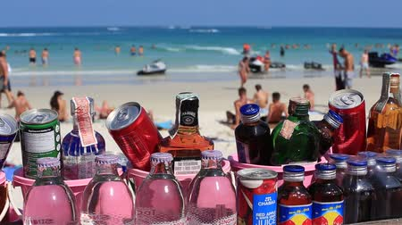alkoholos : KOH PHANGAN, THAILAND - MARCH 02, 2018: Closeup to buckets which have a selection of soft drinks and strong alcohol spirits