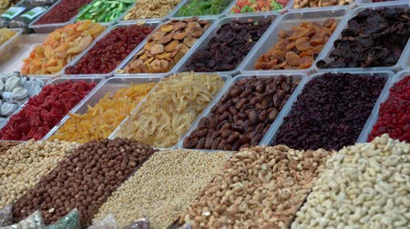kesudió : Dried fruits and nuts in the center of Kiev, Ukraine. Healthy superfoods display, close up