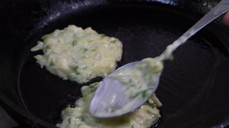 baked pumpkin : Cooking vegetable pancakes on a frying pan from courgettes. Fry of zucchini fritters, close up.