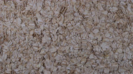 yulaf ezmesi : Rolled oats grains close up. Rotation oat flakes background, macro, top view