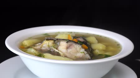 crucian : Fish soup with vegetables. Close up, rotates, healthy food, fish soup, carrot, pepper Stock Footage