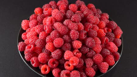 ovocný : Berry, rotation loopable 4k, fresh, ripe, juicy, raspberry background Food background. Gastronomy concept, organic food. Red raspberries fruit Dostupné videozáznamy