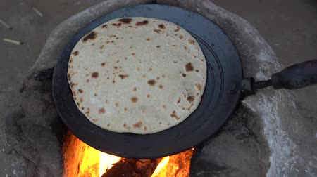 Girl cooking traditional indian bread, chapati, India Wideo