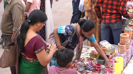 Indian women buy jewelry in the city of Pushkar, Rajasthan, India