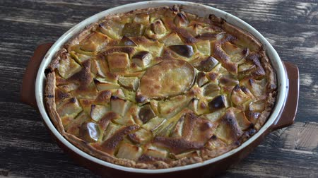 pears : Homemade organic pear pie dessert ready to eat, rotates. Pear tart on the old wooden background, close up. Beautiful organic fresh fruit tart with gluten free crust