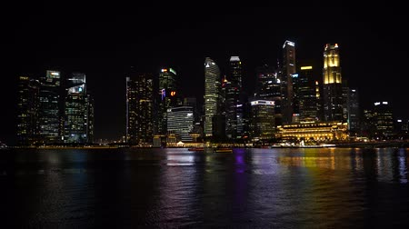 Singapore city, Singapore - February 26, 2020: Singapore Skyline and view of skyscrapers on Marina Bay at night. Singapore cityscape of the financial district Wideo