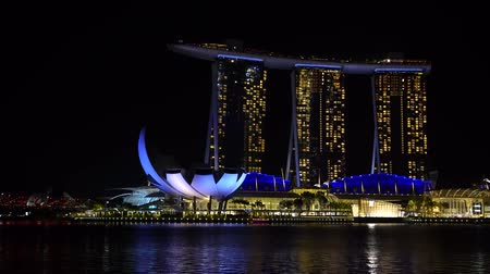 Singapore city, Singapore - February 26, 2020: Marina Bay Sands hotel is an integrated resort fronting Marina Bay at night view in Singapore Wideo