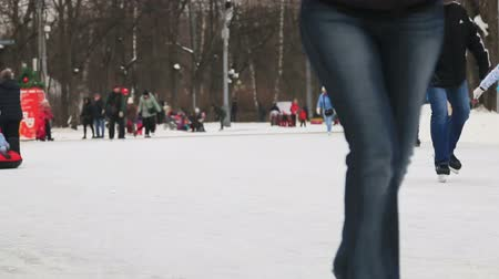 ice skating : Moscow, Sokolniki Park on January 27, 2018: children and adults skate in the park Sokolniki Stock Footage