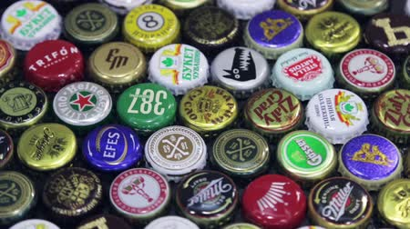 ekstra : Moscow, Russia - April 22, 2018: Background of beer bottle caps, a mix of various global brands: Grolsch, Bud, Bavaria, Miller, Heineken Baltika corona extra etc