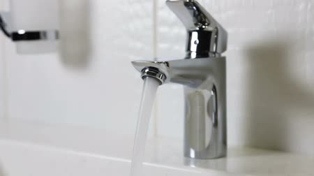 pia : water faucet in a luxurious hotel room or at home in the bathroom. Slider video