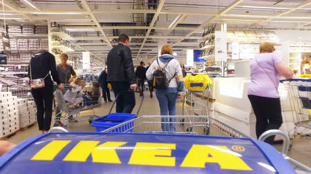 stockpile : Moscow, Russia - may 19, 2018: IKEA customers in the store choosing furniture and accessories. Dutch production and trading company, the owner of retail chains selling furniture Stock Footage