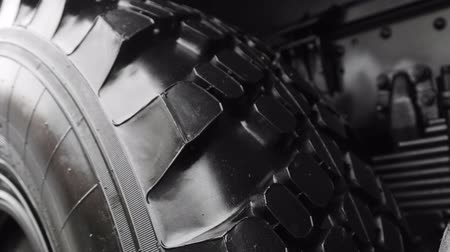 tread : big three of a truck or tractor. The details of the construction or repair of equipment