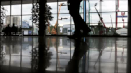 office life : silhouettes of walking people on the background of glass Windows or halls. time lapse video Stock Footage
