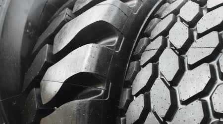 tread : big tyre of a tractor or bulldozer. The details of the construction or repair of equipment