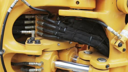 hydraulic : Hydraulic piston system for tractors, bulldozers, excavators. details of construction equipment Stock Footage