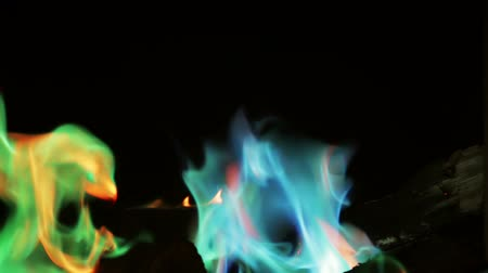 tűzifa : burning firewood in a fireplace or a fire with colored flame