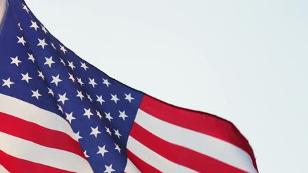 patriótico : usa flag waving in the wind against the blue sky