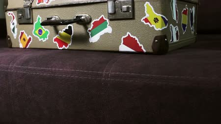 maleta antigua : suitcase stickers of the flags of the countries from travels around the world. Dolly video