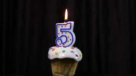 buzlu : cupcake with a burning candle with the number 5. Congratulations on your first birthday. video rotation