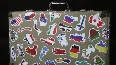 suitcase stickers of the flags of the countries from travels around the world. Rotation video Stock Footage