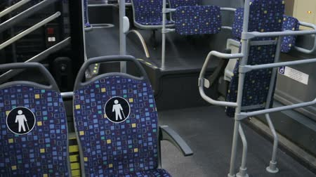 inside bus : modern city bus with seats for disabled and elderly people. Place for a wheelchair in the bus