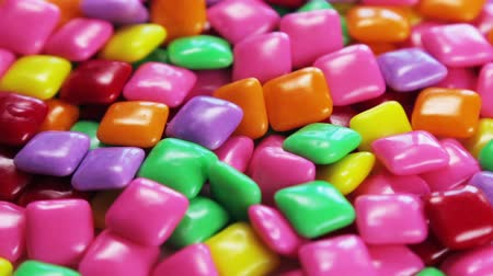 chewing gum of different colors. background of chewing gum. VIDEO dolly