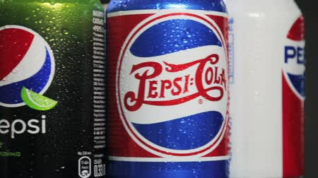 pepsico : Moscow, Russia-October 25, 2018: carbonated Pepsi drink in different packaging design times. Pepsi non-alcoholic carbonated drink produced by the American company PepsiCo