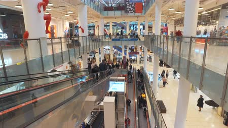 потолок : Moscow, Russia-October 20, 2018: buyers in the shopping Mall Aviapark in Moscow. The total area is 390,000 m2, making it the largest in Europe by total area