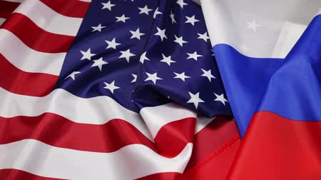 disagreement : Usa flag and Russia flag. Textile flags of the world. Dolly video