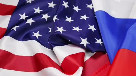 Usa flag and Russia flag. Textile flags of the world. Dolly video