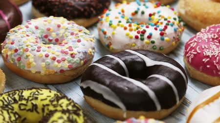 envidraçado : assorted donuts with different fillings and icing. Dolly video