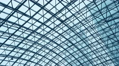 sobreposição : glass roof of a modern evening time building. The overlap of the roof of the building
