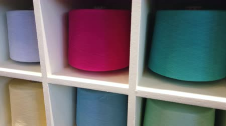 závit : different color spools of thread for the textile industry. background. camera movement Dostupné videozáznamy