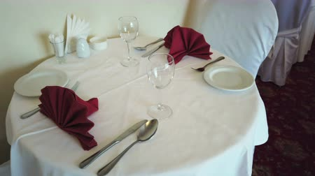 settings : served table in the restaurant ready to receive visitors