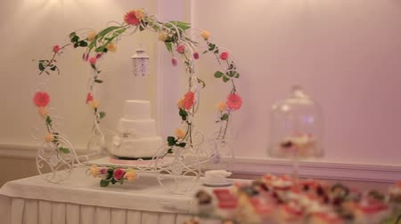 wedding cake : beautiful wedding cake and sweet buffet table Stock Footage