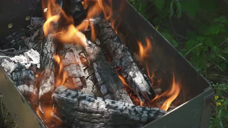 aglow : Charcoal on fire in a BBQ grill Stock Footage